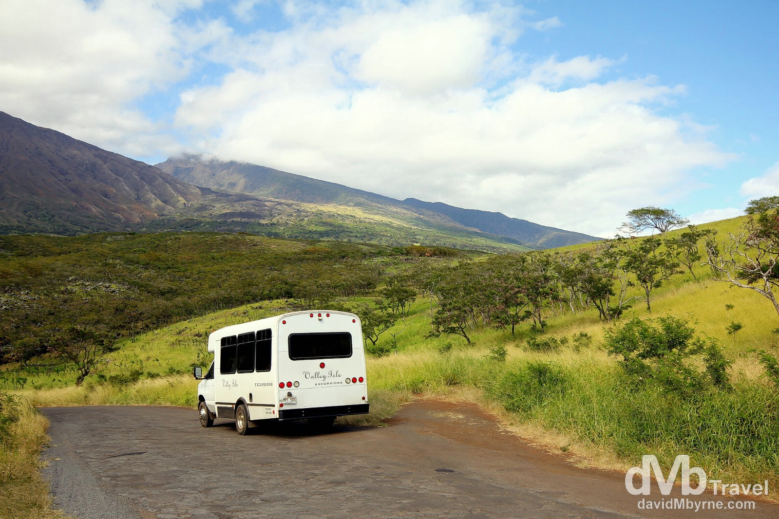 A Valley Isle Excursions van on a section of the 'Road To Hana' tour on the Piilani Highway/Kalama Park Road in southern Maui, Hawaii, USA. March 7th 2103.