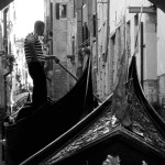Being punted through the canals of Venice, Veneto, Italy. August 27th, 2007.