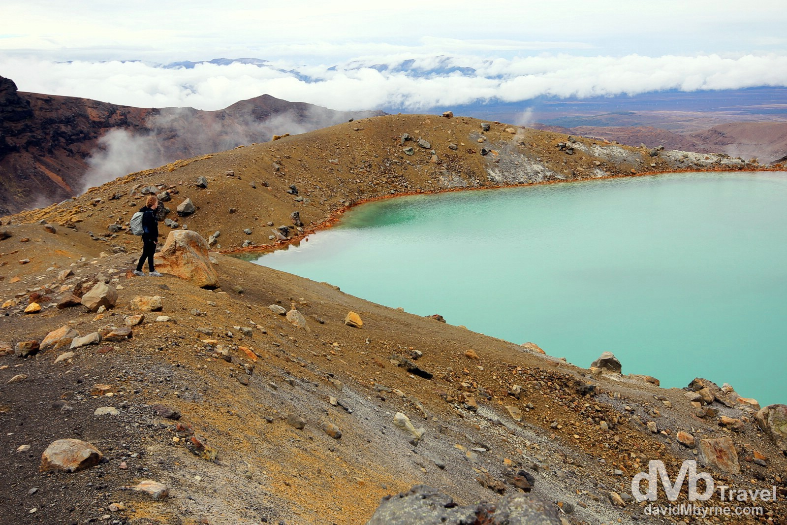 Standing by an emerald green volcanic lake in Tongariro National Park, North Island, New Zealand. May 9th 2012.