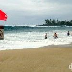Only serious surfers allowed in the waters of Waimea Bay, North Shore, Oahu, Hawaii, USA. March 10th 2013.
