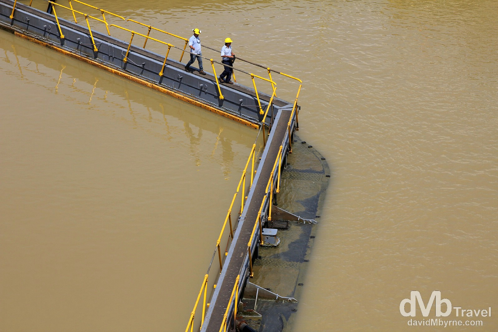Workers crossing the Miraflores Locks of the Panama Canal, Panama. July 1st 2013.