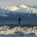 Paddle boarding off the Spit in Homer, Kenai Peninsula, Alaska, USA. March 18th 2103.