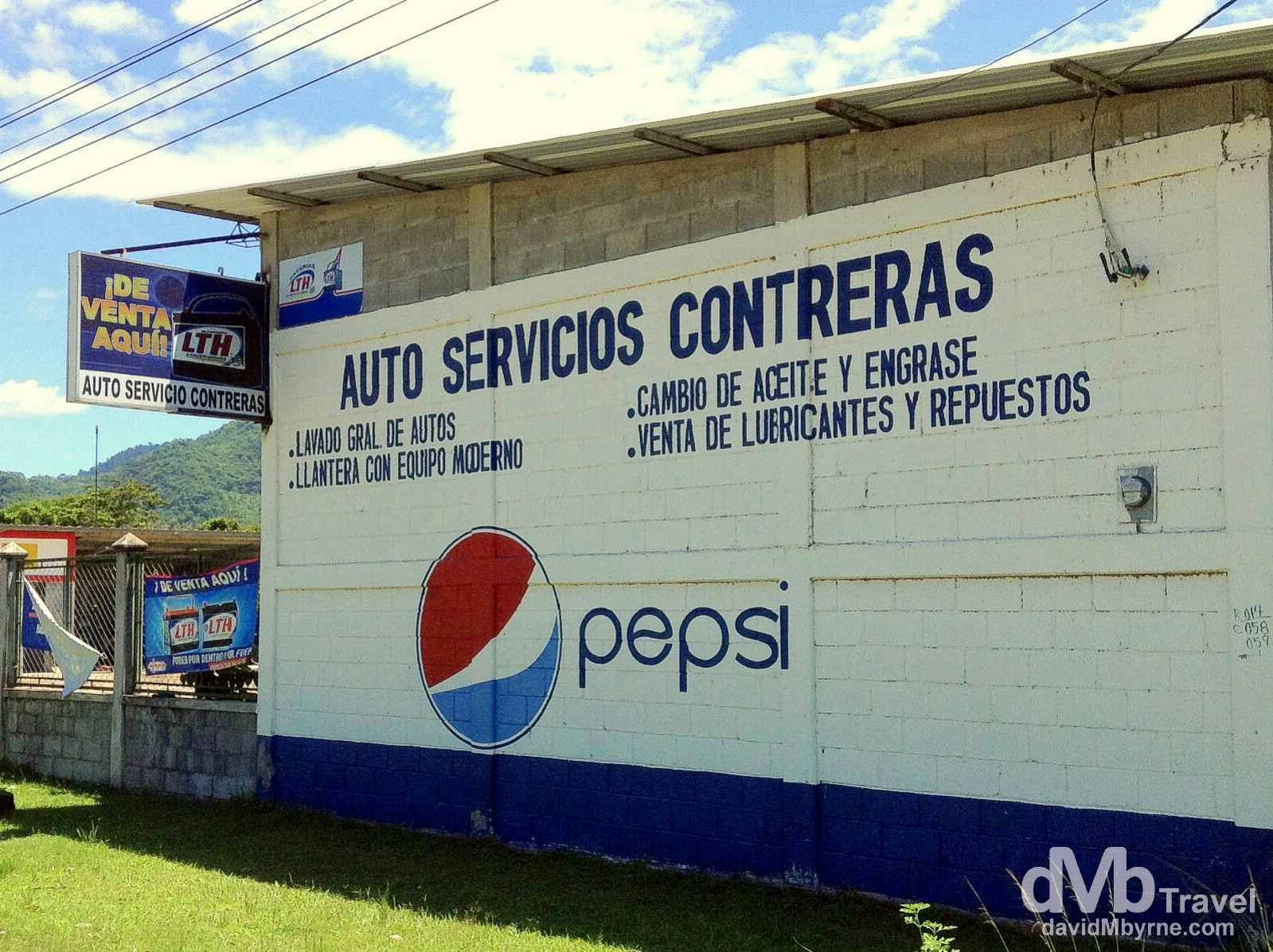 One aspect of Central America that I've noticed is the abundance of Pespi advertising. It's everywhere, like here on the side of a garage on the outskirts of the village of Pina Blanca. In this part of the world at least Coco-Cola plays a distant second fiddle to the big P. Western Honduras. June 12th 2013. (iPod)