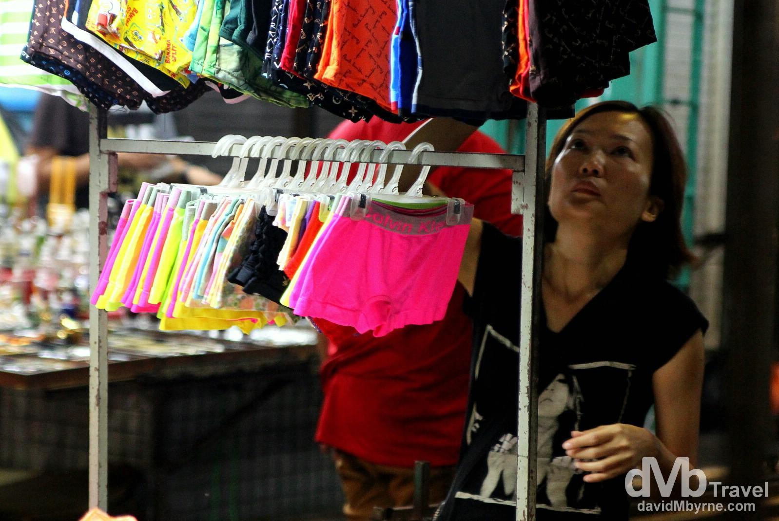 A trader in Petaling Street Market, Kuala Lumpur, Malaysia. March 30th 2012.