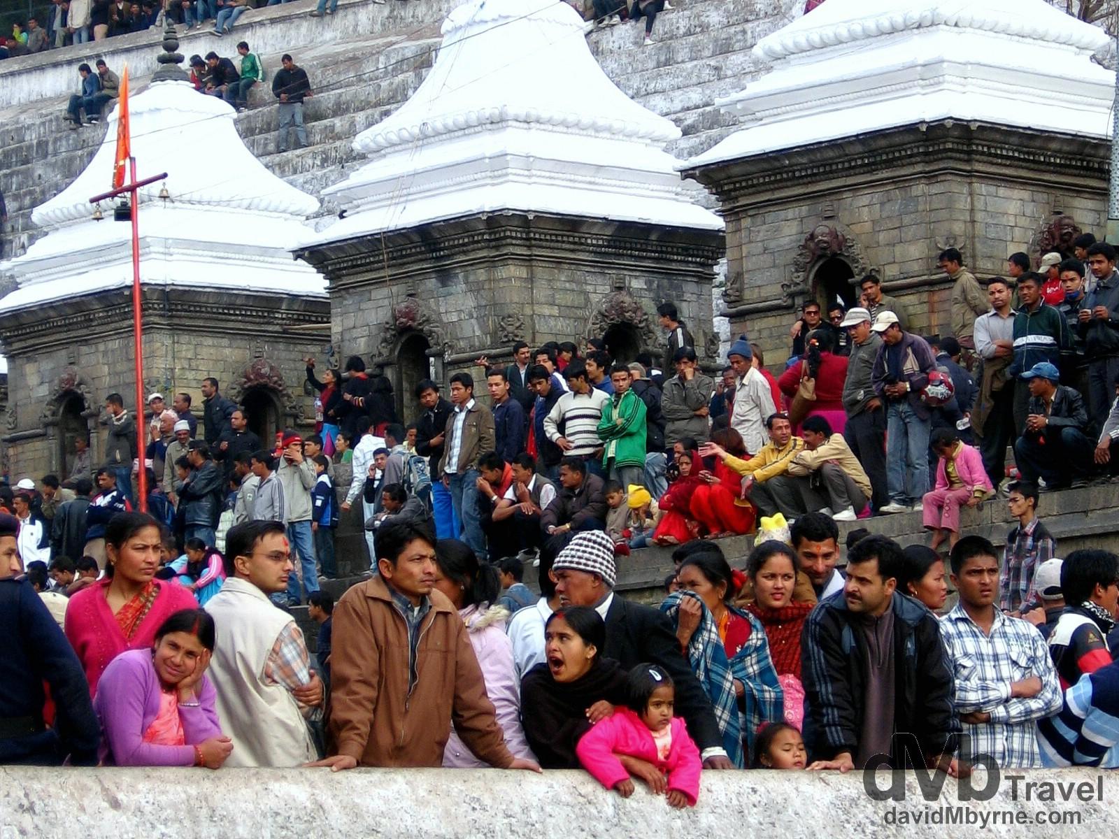 Crowds in the grounds of Pashupatinath celebrating the birthday of the revered Hindu God Shiva. Kathmandu, Nepal. March 6th 2008