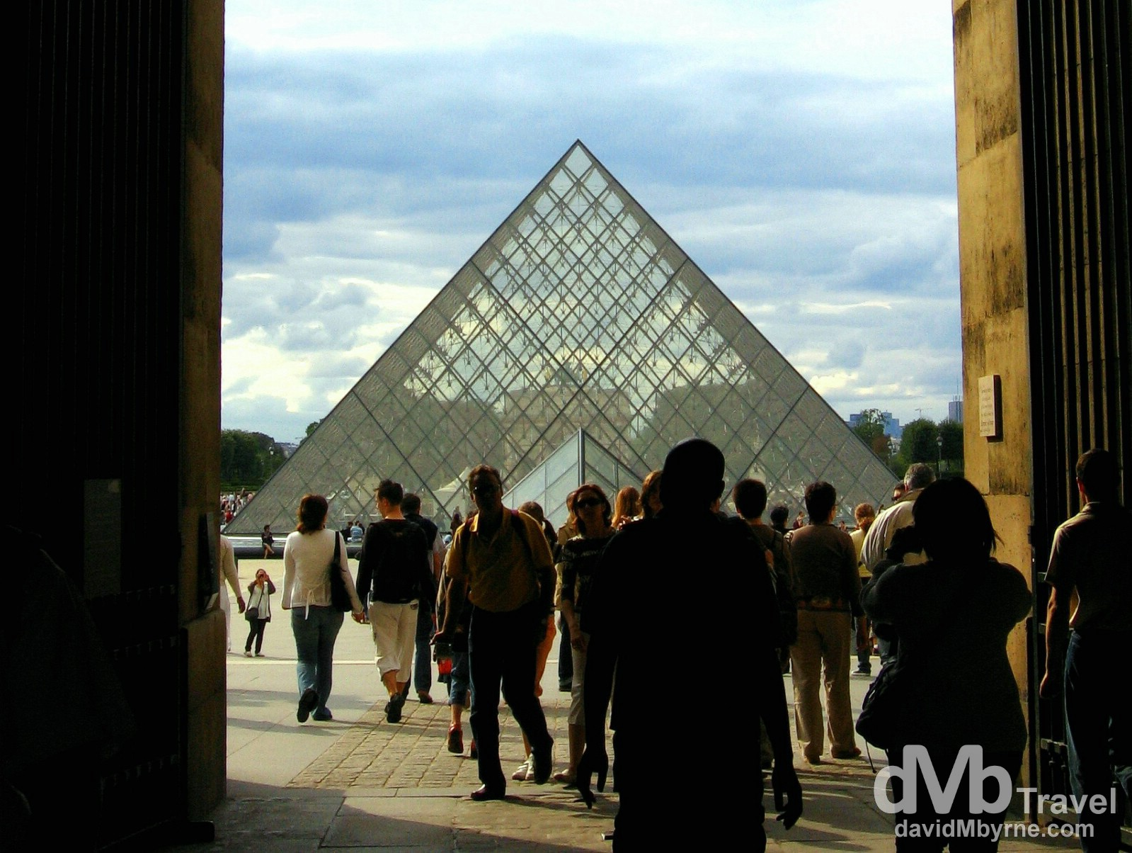The Louvre Pyramid in the centre of the Napoleon Courtyard as seen through an opening in the Palais du Louvre (Louvre Palace), Paris, France. August 18th 2007