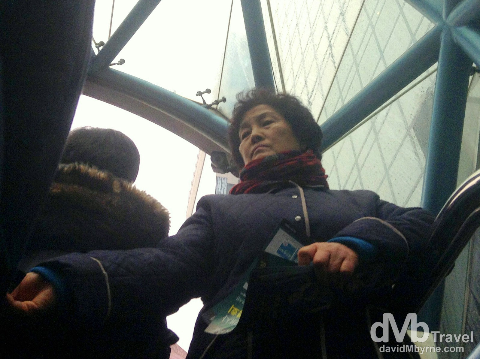 An Ajumma handing out flyers at exit 12 of Gangnam Station, Seoul, South Korea. January 25th 2014.