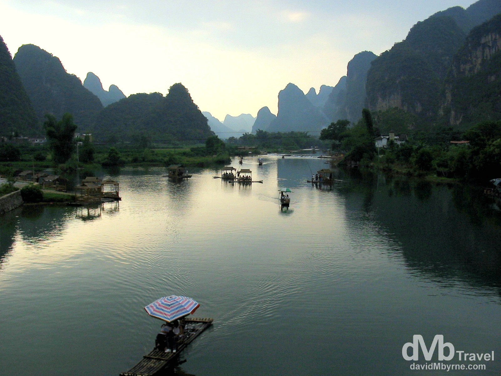 Getting punted near sunset on a section of the Li River outside Yangshuo, Guangxi Province, Southern China. September 11th, 2004.