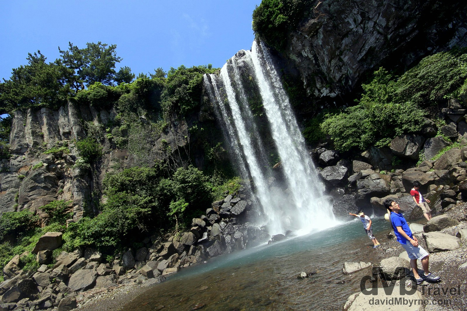 Jeongbang Waterfall, the only waterfall in Asia to fall directly into the ocean. Jeju Island, South Korea. July 16th 2011