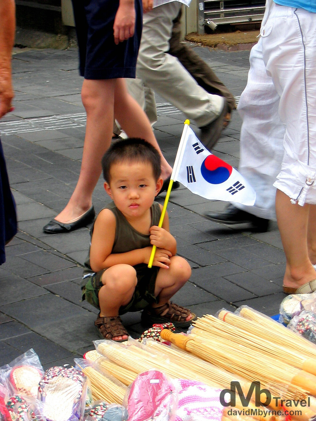 A young flag-bearer in Insadong, Seoul, South Korea, on Korean Independence Day. August 15th 2004