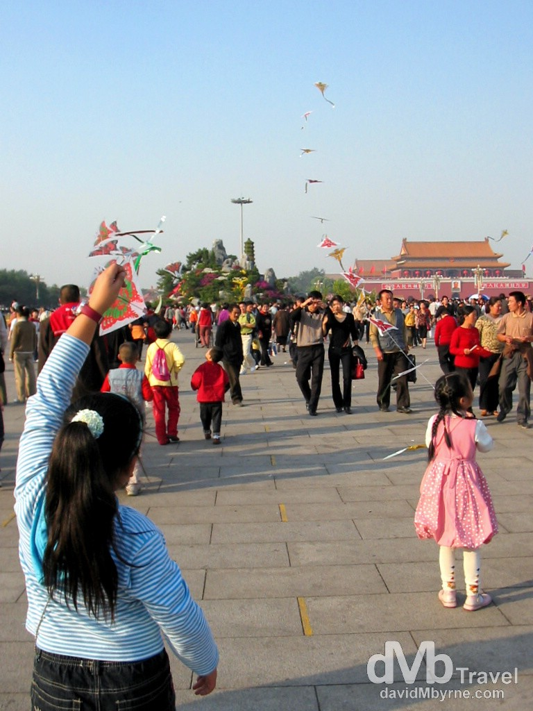 Flying kites in Tiananmen Square during National Day Golden Week celebrations. Tiananmen Square, Beijing, China. October 3rd, 2004