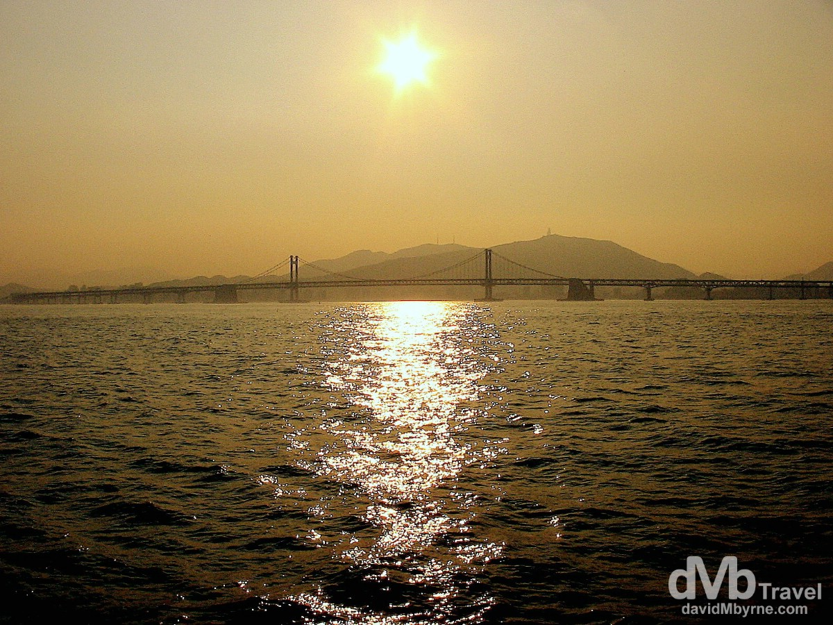 Sunset over the Gwangan Bridge as seen from the Oryukdo Ferry. Busan, South Korea. July 21st, 2004