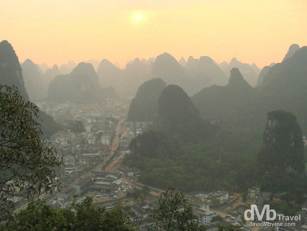 Sunset over Yangshou from the top of Bi Lian (Green Lotus) Hill. Yangshou, Guangxi Province, Southern China. September 13th, 2004.