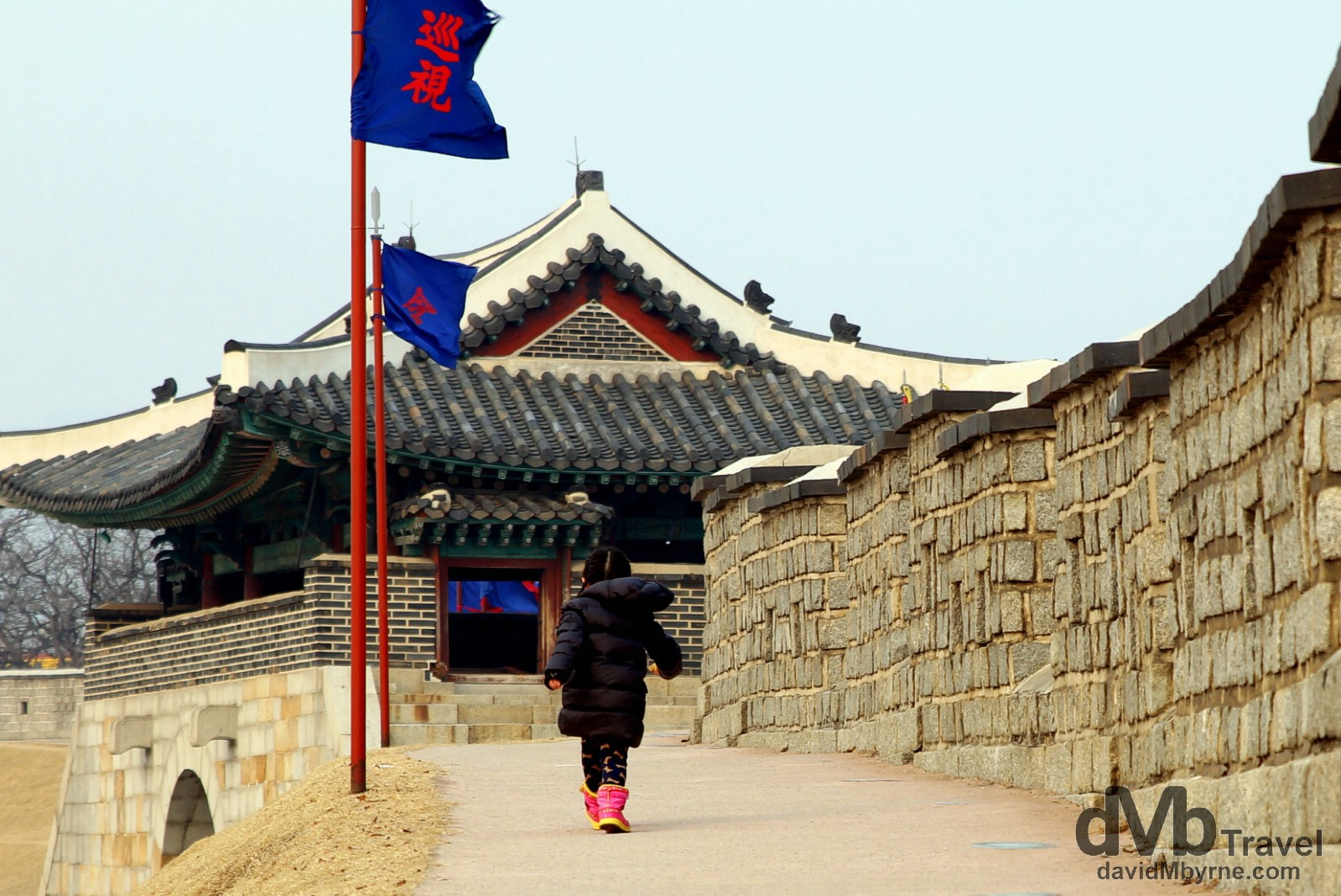 A young girl walks a section of the Suwon Hwaseong Fortress in Suwon, South Korea. February 23rd, 2014.