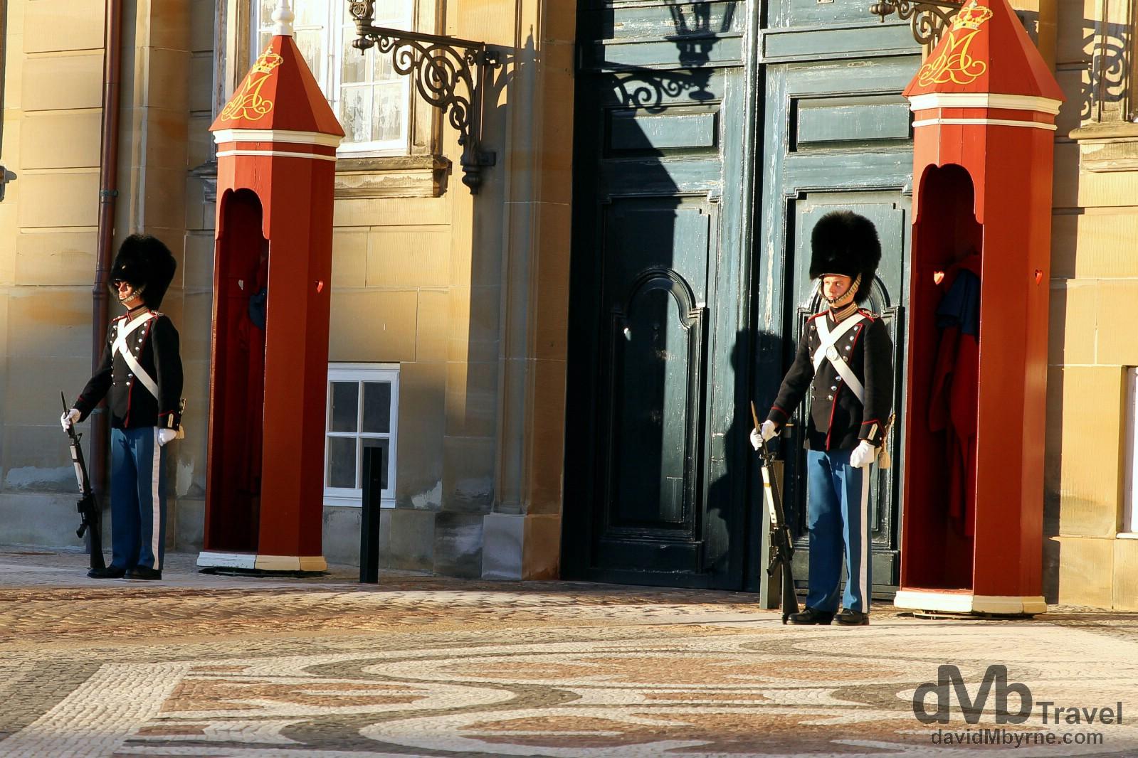 Guards outside Amalienborg, the winter residence of the Danish Royal family, in Copenhagen, Denmark. March 12th, 2014.