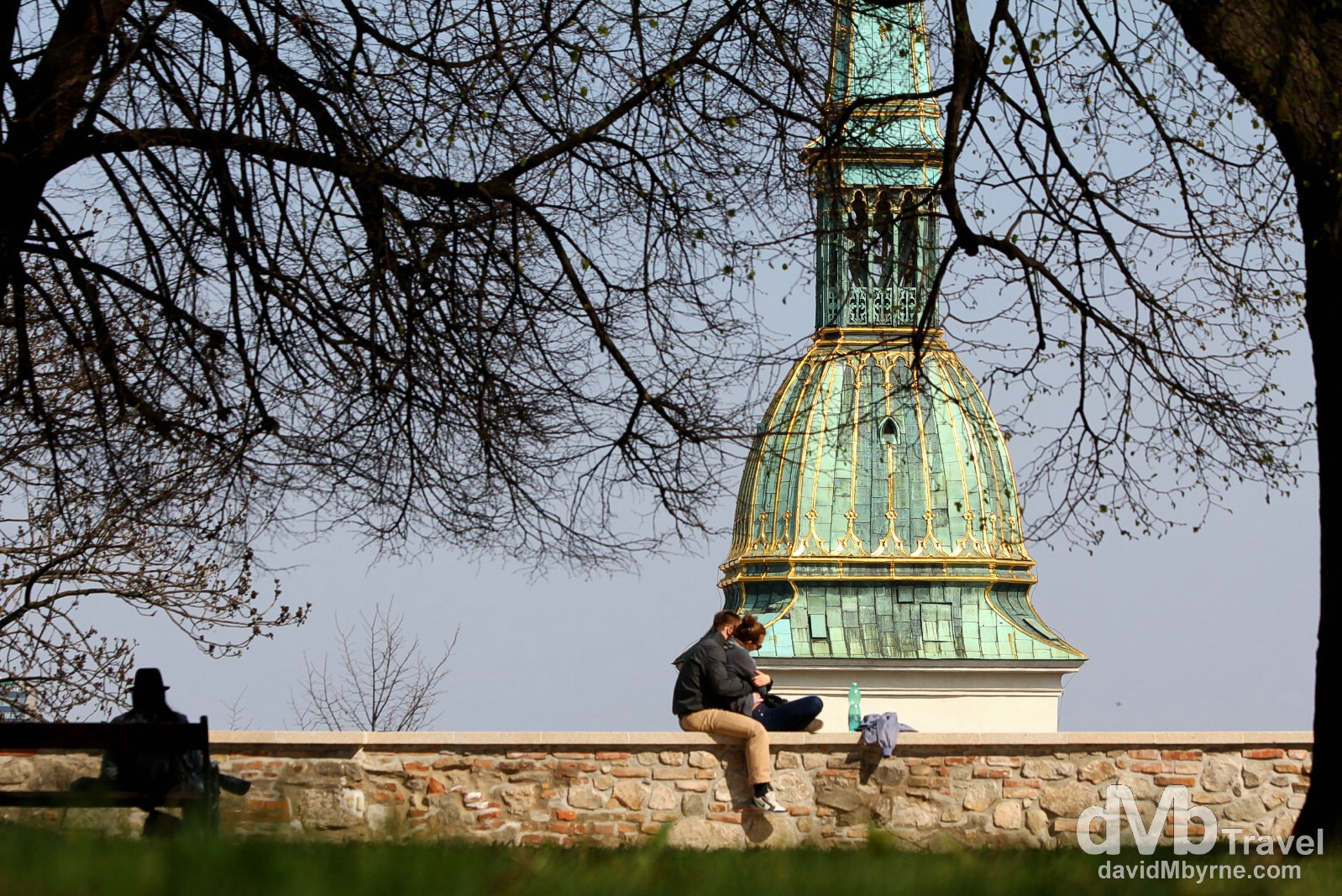 In the grounds of Bratislava Castle with the spire of Dom Sv. Martina (St. Martin's Cathedral), the city's most important church, in the background. Bratislava, Slovakia. March 28th, 2014.