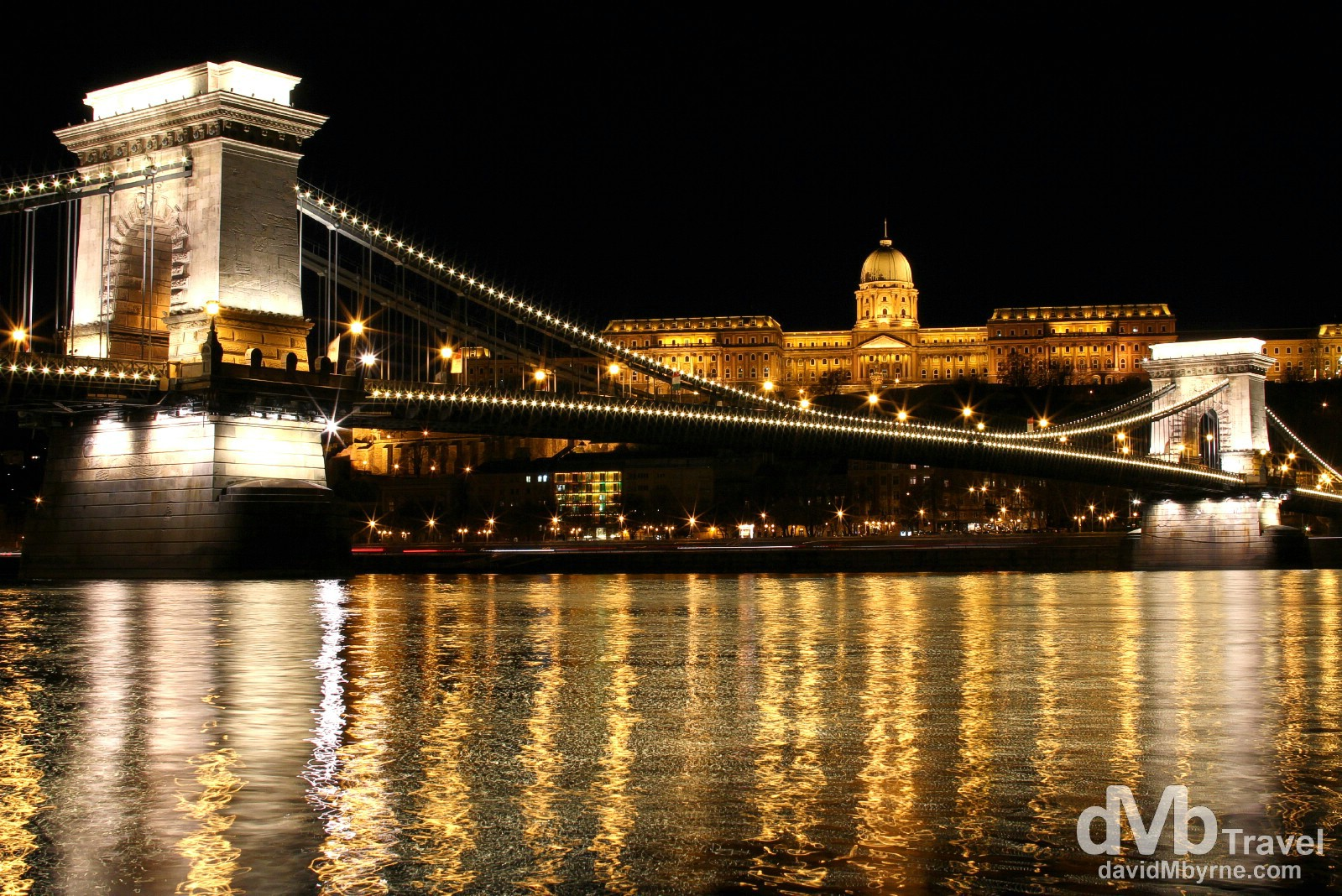 The Royal Palace in Buda & the Chain Bridge spanning the Danube as seen from the riverfront in Pest. Budapest, Hungary, March 25th, 2014.