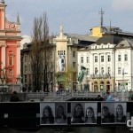 Looking towards Presernov trg (square) & the Triple Bridge from the edge of the Ljubljanica River in Ljubljana, Slovenia. March 22nd, 2014.
