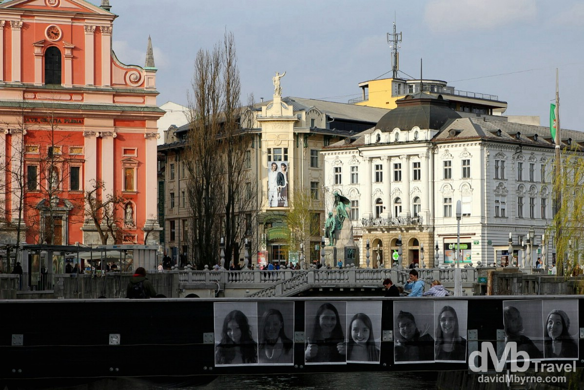 Looking towards Presernov trg (square) & the Triple Bridge from the edge of the Ljubljanica River in Ljubljana, Slovenia. March 22nd, 2014.