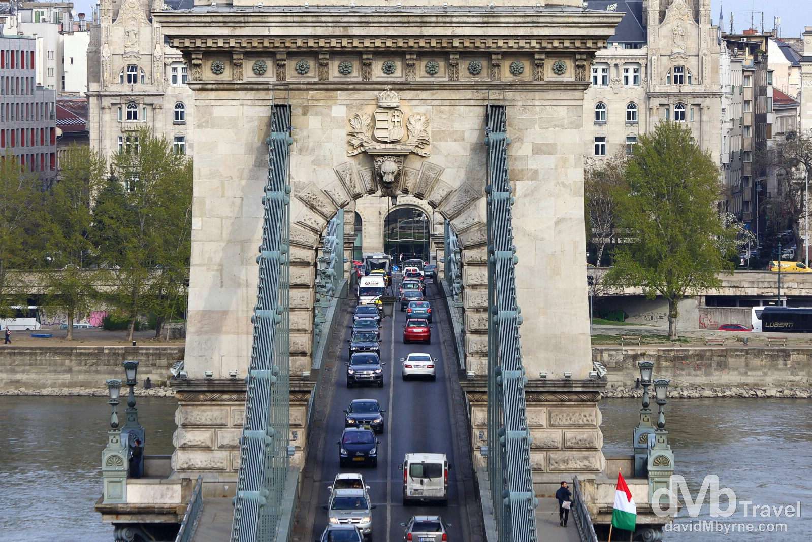Traffic on the Chain Bridge spanning the Danube River in Budapest, Hungary. March 26th, 2014.