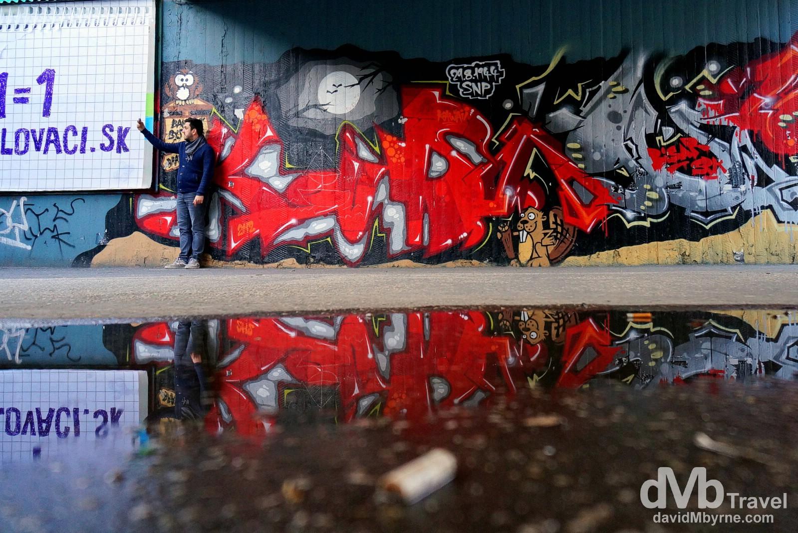 A selfie with the graffiti of Novy most (bridge) in Bratislava, Slovakia. March 27th, 2014.