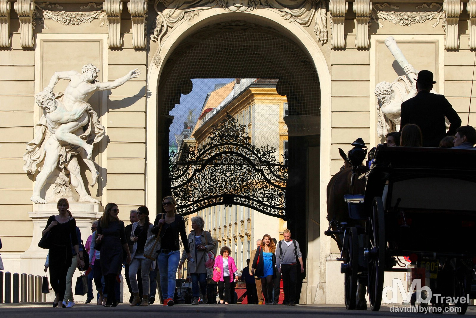 Passing through Michaelertor, the north-eastern gate of the Hofburg, the former Royal Palace in Vienna, Austria. March 29th, 2014.