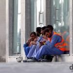 Constructions workers on the streets of Abu Dhabi after days work in the desert heat. Abu Dhabi, UAE. April 23rd, 2014.