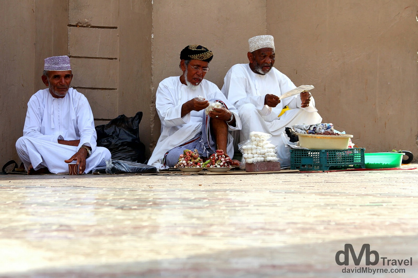 Setting up to begin selling outside the Mutrah Souq (marketplace) in Muscat, Oman. April 25th, 2014.