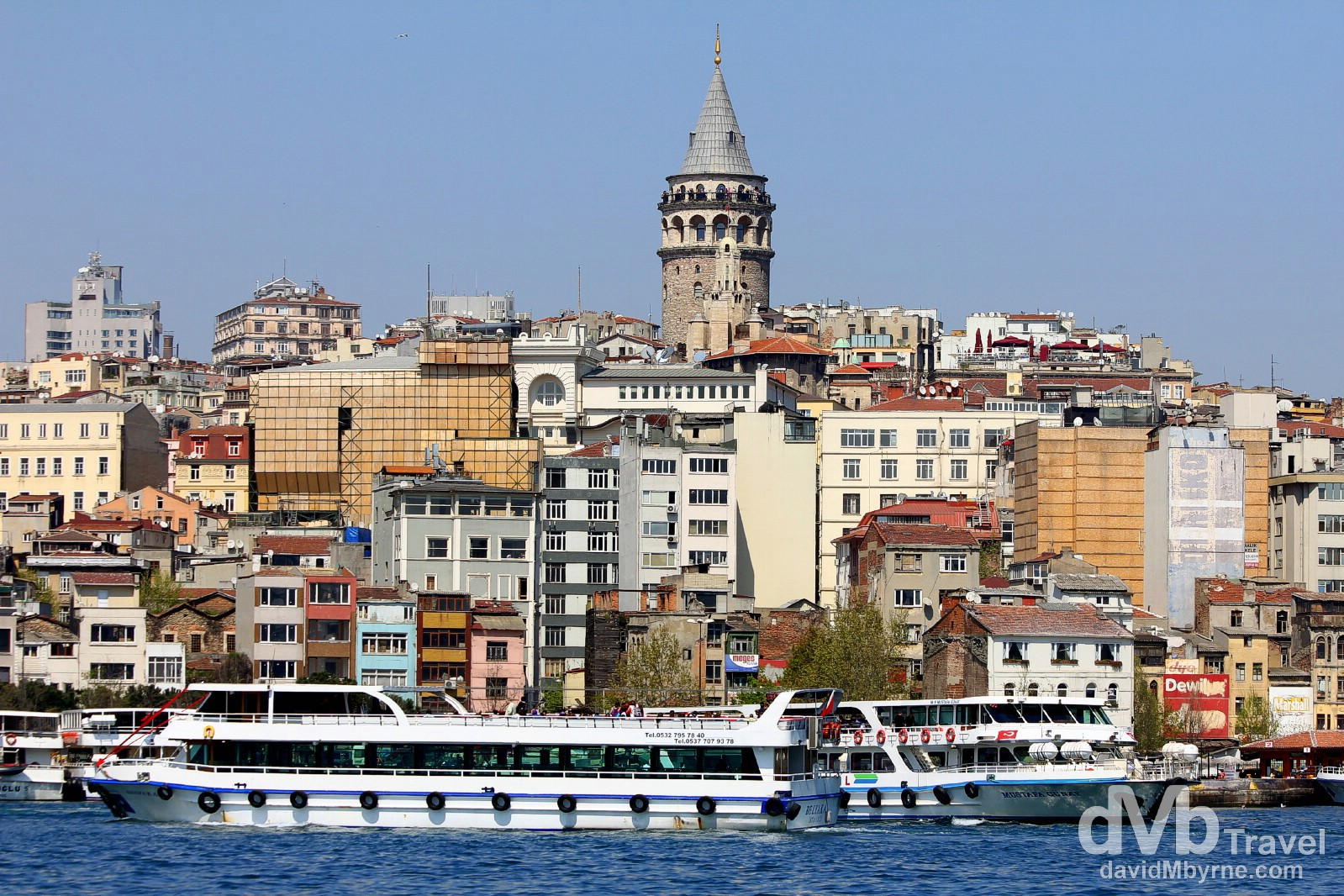 Boats on the Bosporus & the 1348 Galata Tower, a prominent landmark in the Galata district of Istanbul, Turkey. April 10th, 2014.