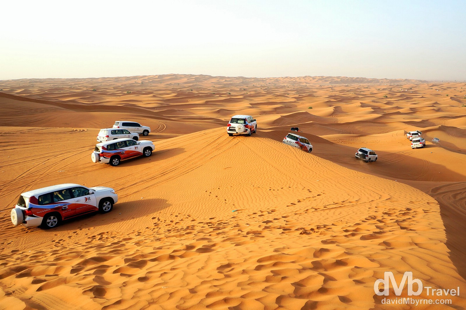 4x4 off-road dune bashing convoy in the expansive desert outside Dubai, UAE. April 17th, 2014.