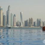 The towers of Dubai Marina as seen from the infinity pool of the Oceania Beach Club, Palm Jumeirah, Dubai, UAE. April 19th, 2014.