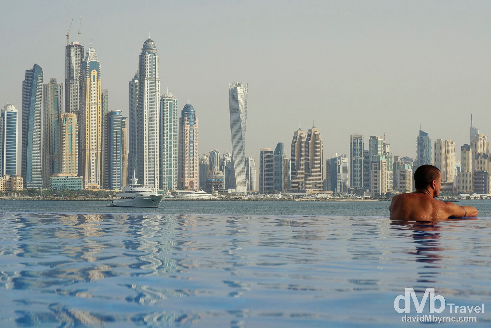 The towers of Dubai Marina as seen from the infinity pool of the Oceania Beach Club, Palm Jumeirah, Dubai, UAE. April 19th, 2014.