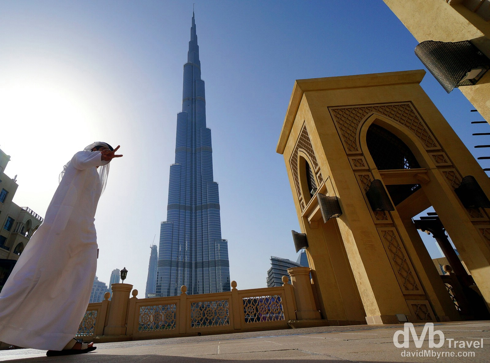 V sign at the base of the 829.8-metre Burj Khalifa, the tallest building in the world. Dubai, UAE. April 14th, 2014.