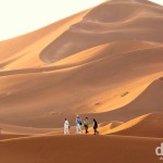 An early morning stroll among the massive sand dunes of Erg Chebbi in Morocco. May 19th, 2014.