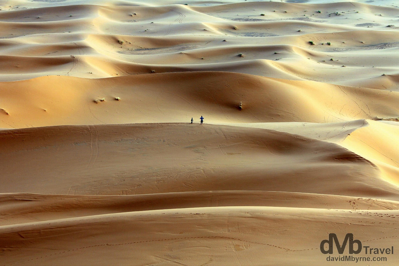 Walking on the sand dunes of Erg Chebbi outside the village of Merzouga, Morocco. May 19th, 2014.