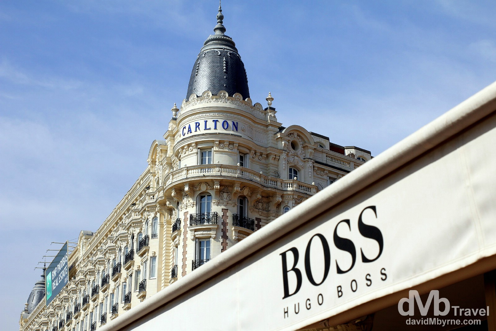 The iconic Carlton Hotel & a Hugo Boss store fronting the waterfront promenade bd de la Croisette in Cannes, Côte d'Azur, France. March 15th, 2014.
