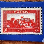 A reproduction of an old Maroc (Morocco) stamp on the walls of the Kasbah Taourirt in Ouarzazate, Morocco. May 13th, 2014.
