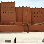 Walking in front of the walls of the Kasbah Taourirt in Ouarzazate, Morocco. May 13th, 2014.