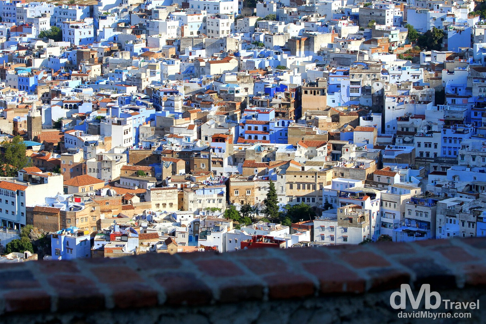 The rising sun creeps over a portion of the Chefchaouen Old Town as seen from the hills overlooking the town. Chefchaouen, Morocco. June 1st, 2014.