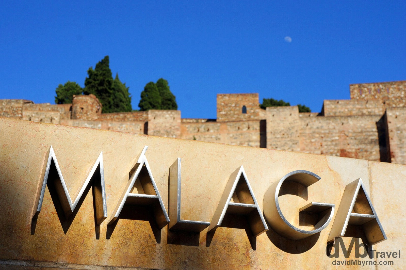 A sign fronting the Roman theater in central Malaga. Andalusia, Spain. June 8th, 2014.