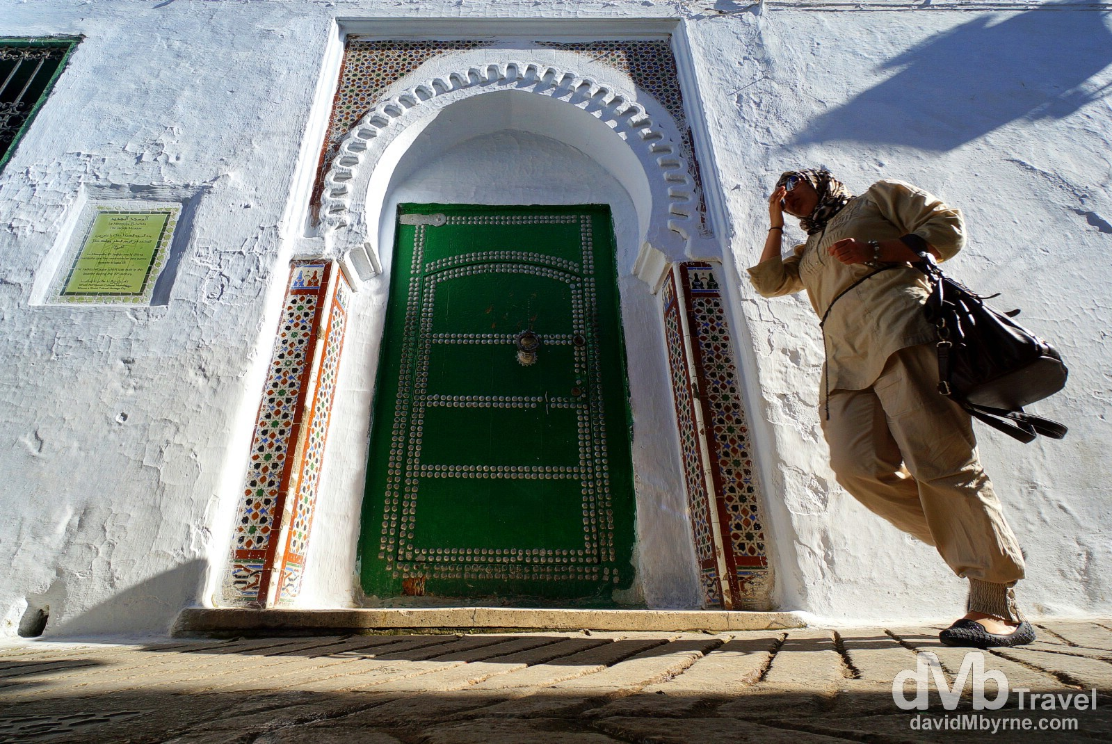 Walking by an entrance to the Jadid Mosque inside the walls of the UNESCO-listed medina in Teotuan, Morocco. June 2nd, 2014.