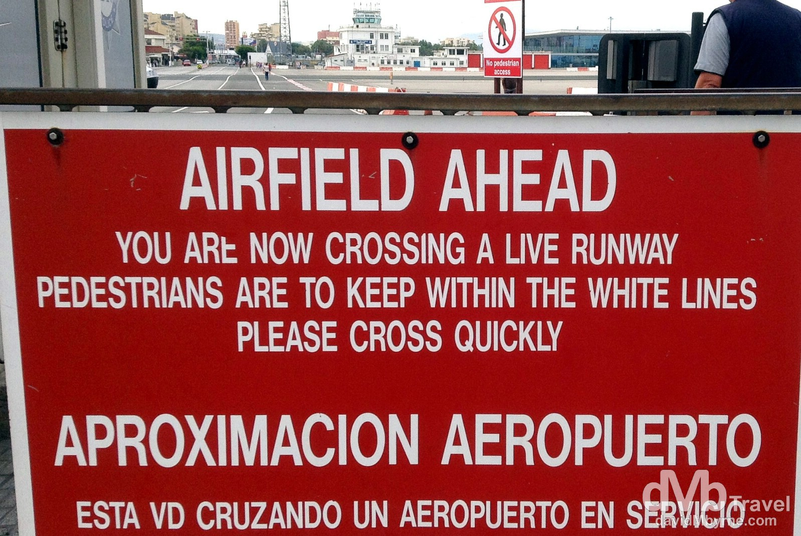 A sign either side of the pedestrian crossing on the runway of the International Airport in Gibraltar. June 5th, 2014.