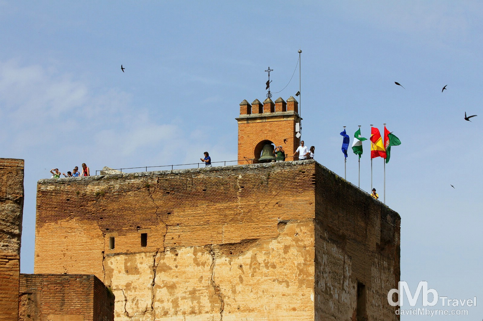 People atop the Torre de la Vela (Watchtower) in the Alcazaba (Citadel) in Granada, Andalusia, Spain. June 11th, 2014.