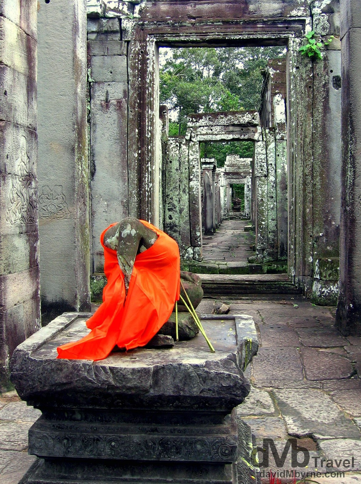 A headless Buddha in the ruins of the temples of Angkor, Cambodia. September 20th, 2005.