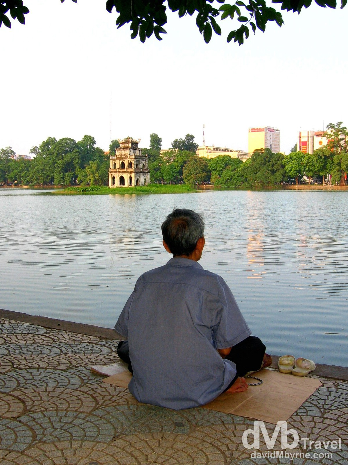 Sitting by the edge of Hoan Kiem Lake in Hanoi, Vietnam. September 5th, 2005.