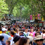 People on Spain's most famous street, La Rambla in Barcelona, Catalonia, Spain. June 18th, 2014.
