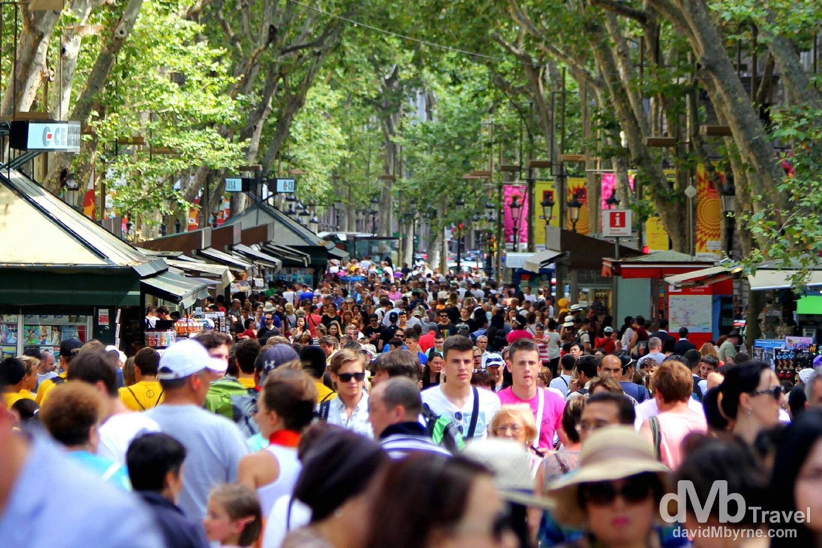 People on Spain's most famous street, La Rambla. Barcelona, Spain. June 18th, 2014.