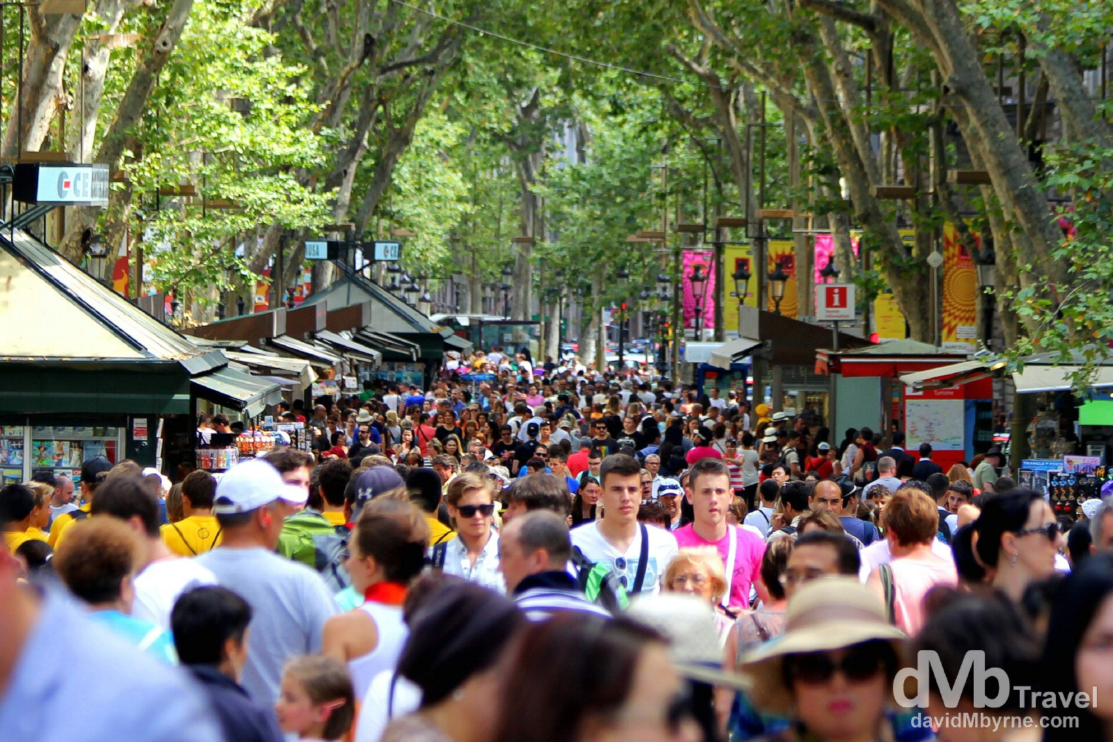 People on Spain's most famous street, La Rambla. Barcelona, Spain. June 18th, 2014.