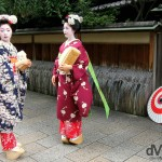 Maiko, trainee Geisha, on the streets of the Gion district of Kyoto, Honshu, Japan. July 18th, 2005.