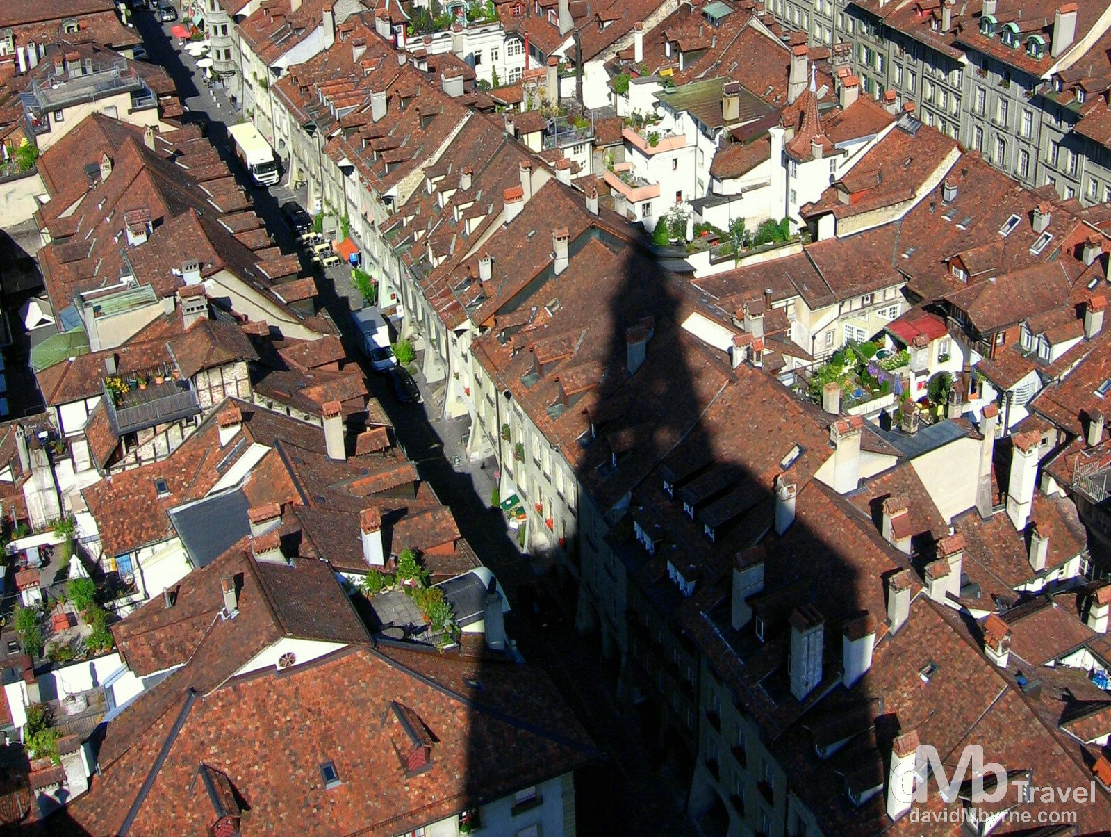 The spire of the late-Gothic Cathedral, or Münster, casts a shadow over the roofs of Old Town in Bern, Switzerland. August 24th, 2007.